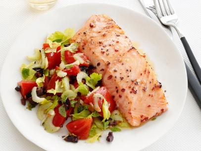 Salmon with warm olive-tomato salad
